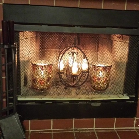 I just gave the fireplace a facelift. Gregg and I hit Pier One